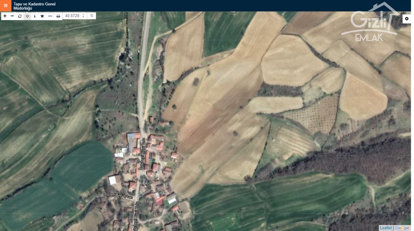 ORUÇBEYLİ MAHALLESİNDE MERKEZİ KONUMDA 8.200m2 İMARLI  TARLA